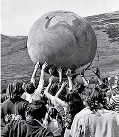 People holding up a model of the earth